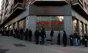 The line-up outside an unemployment registry office in Madrid. Photograph: Wind turbines a La Muela near Zaragoza. Wind power was the top generator of electricity in Spain in 2013. Photograph: Andres Kudacki/AP